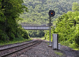 Automatic block signaling - Searchlight type automatic block signal at Milepost 122.2 on the Reading Blue Mountain and Northern Railroad Lehigh Line (former Lehigh Valley Railroad) in Jim Thorpe, Pennsylvania