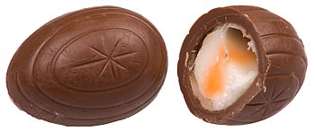 English: A whole and split Cadbury Creme Egg.