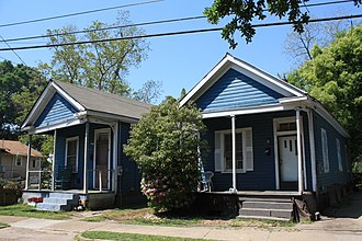 Vernacular architecture - The Shotgun house is an example of an American vernacular: A pair of single shotgun houses, dating to the 1920s, in the Campground Historic District of Mobile, Alabama
