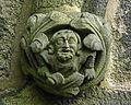 Carved figure on Denholme church (12139174216).jpg