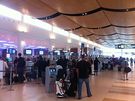 Airline check-in counters at Winnipeg International Airport Checkin Winnipeg Airport.jpg