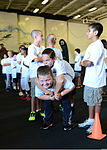 Children of U.S. Sailors assigned to the aircraft carrier USS Ronald Reagan (CVN 76) participate in the National Football League's Play 60 program in the ship's hangar bay Aug. 28, 2013, in San Diego 130828-N-SS432-021.jpg