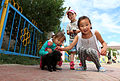 Children show off their puppy before the opening ceremony for Khaan Quest 2013 in Ulaanbaatar, Mongolia, Aug. 2, 2013 130802-M-MG222-007.jpg