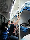 Crowded sleeper train with 3-level bunks