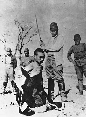 Nanking Massacre denial -  A Chinese POW about to be beheaded by a Japanese officer with a shin gunto during the Nanking Massacre.