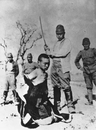 Nanjing Massacre denial - A Chinese POW about to be beheaded by a Japanese officer with a shin gunto during the Nanking Massacre.