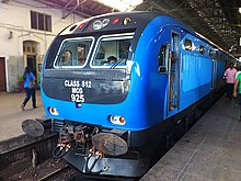 Blue locomotive in a station