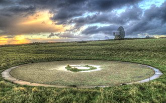 RAF Cleave - Remains of an RAF Cleave gun emplacement, with the modern satellite dishes of GCHQ Bude behind