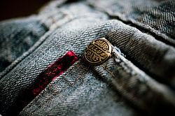 Denim as used for blue jeans, with a copper rivet to strengthen the pocket.
