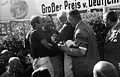 Collins Fangio and Hawthorn celebrate Nurburgring 1957.jpg