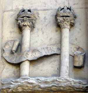 "Dollar sign -  The Pillars of Hercules with a small ""S"" shaped ribbon around in the City of Seville, Spain (16th century)."