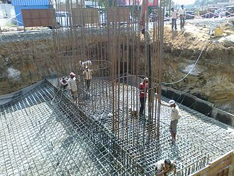 Migrant labourers in Kerala - Concrete pumping for an abutment