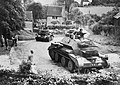 Cruiser Mk IV tanks of 5th Royal Tank Regiment, 1st Armoured Division, driving through a Surrey village, July 1940. H2491.jpg