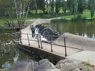 Weir - A weir on the Yass River, New South Wales, Australia directly upstream from a shared pedestrian-bicycle river crossing.