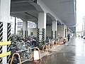 Cycle park under Tokaido Shinkansen viaduct in Kusanagi station.jpg