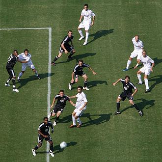 Ben Olsen - Olsen (center) defending a corner kick during an international friendly against Real Madrid C.F. in 2009 at FedExField