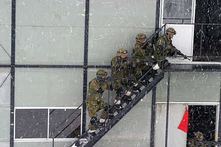 JGSDF soldiers practice MOUT tactics in the Ojojibara Maneuver Area of Sendai, Japan during an exercise in 2004. DM-SD-06-06300.JPEG