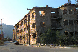 Croat–Bosniak War - Damaged buildings from the fighting on the Croatian side of Mostar