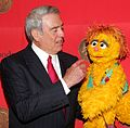 Dan Rather and Kami (the HIV positive muppet) (8226314115).jpg
