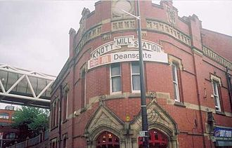 "Deansgate - Deansgate railway station: station frontage which features the previous ""Knott Mill"" name"