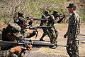 Defense.gov News Photo 110315-N-EC642-056 - U.S. Marine Corps Staff Sgt. Daniel Monteiro right assigned to Marine Corps Training and Advisory Group teaches proper tactical movement.jpg