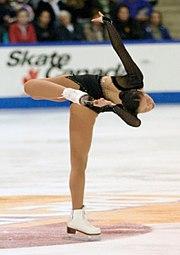 Shizuka Arakawa performs a donut spin (camel-variation)