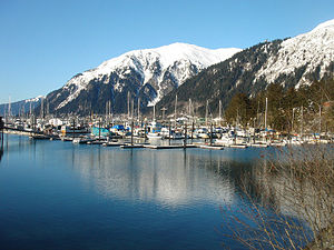 Douglas Island - Douglas Harbor in Douglas, Alaska. Mayflower Island, in the midground at right, houses a U.S. Coast Guard station. Mount Juneau is in the background.