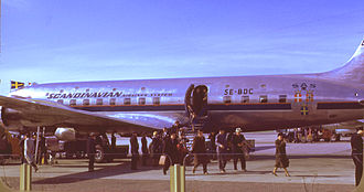 Douglas DC-6 - Passengers alighting from an SAS DC-6: Note the upper row of windows, indicating this was built as the optional sleeper variant of the original-length DC-6