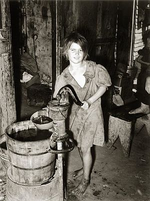 Recession of 1937–38 - Scene in an agricultural worker's shack town, Oklahoma City, July 1939