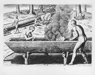 Maritime history - Indigenous Americans making a dugout canoe, a practice which they had done for centuries.
