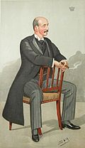 A caricature of a bald man with a moustache, wearing morning dress and sitting astride a wooden chair, a smile on his face and a cigar in his hand.