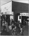 Eloy, Pinal County, Arizona. Crowds of cotton pickers on main street of Eloy late Saturday afternoon. - NARA - 522055.tif