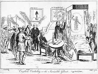 Le dessin montre un lit à la gauche. Un fantôme brandit un marteau au dessus de deux enfants dormant dans le lit. Un ecclésiastique regarde sous le lit avec une bougie. À la gauche du lit se trouvent des gens échangeant des commentaires qui apparaissent dans des phylactères. À la droite du lit, plusieurs femmes sont en prières.
