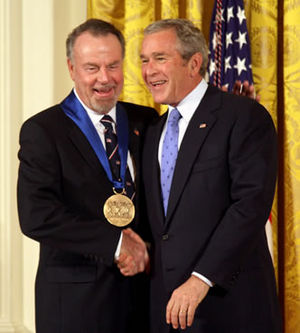 Erich Kunzel - Erich Kunzel (left) receives the 2006 National Medal of Arts from President George W. Bush (right) at a 2007 ceremony.