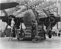Experienced assembly line workers of both sexes contribute to the production of A-20 attack bombers in the Douglas... - NARA - 196397.tif