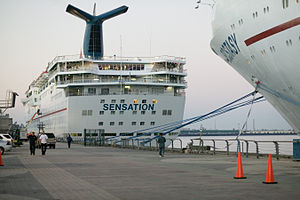 Effects of Hurricane Katrina in New Orleans -  Carnival Cruise Ships  Ecstasy  and Sensation docked in Port of New Orleans while used for housing purposes for victims.