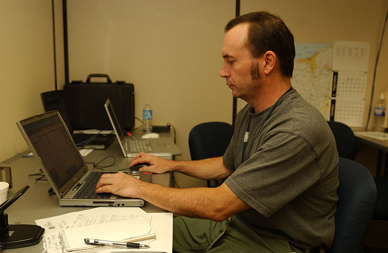 File:FEMA - 32323 - FEMA photographer Mark Wolfe working at a computer in Findlay, OH JFO.jpg