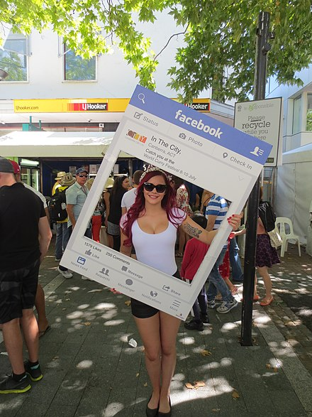 Human billboard at the National Multicultural Festival being used to advertise Facebook news feed Facebook advertising.jpg