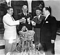 File-Black & white photograph, group portrait-Maurice Bathhouse crystal fountain, 4 men toasting each other with cups of hot water (963de316-a561-455b-9f60-27d0118b829c).jpg