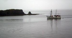 Fishing boat entering Kodiak harbor.jpg
