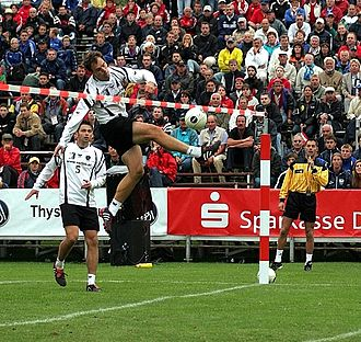 Fistball - A fistball attacker hits the ball over the net