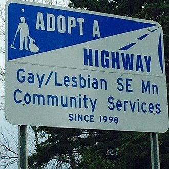 Adopt-a-Highway - An adopt-a-Highway sign on Interstate 90 in Minnesota since 1998.