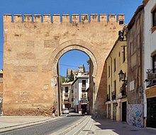 A beige-coloured city gate