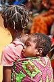 Ghana child sleeps at health event (7250640274).jpg