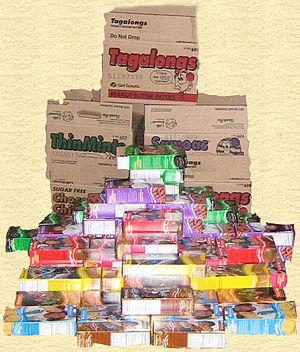 Girl Scout Cookies - A mound of boxes and cases of Girl Scout cookies. This mound contains 74 boxes of cookies
