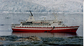 MS Explorer in Antarctica in January 1999. She sank on 23 November 2007 after hitting an iceberg. Glacier and Explorer.jpg