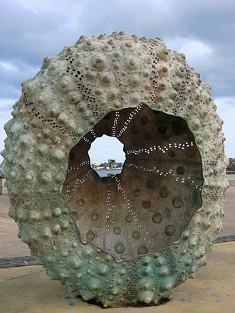 Rachel Joynt - Mothership Sculpture at the coastline in Glasthule, Dublin; James Joyce Tower in the distance can be seen in the middle of the picture