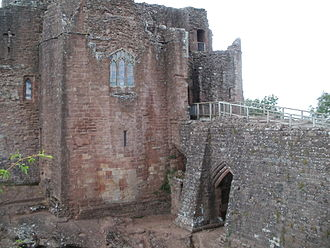Goodrich Castle - The gatehouse is reached by an exposed causeway covered by the barbican to the right of the picture. The chapel window can be seen in the left-hand tower.
