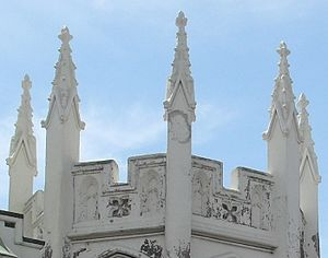 Gothic House - Ornate crocketted pinnacles adorn the roof of the tower.