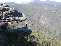 View of the Balconies rock formations including one formerly known as the Jaws of Death since it appears to be an open mouth of two rock slabs with a hiker standing inside